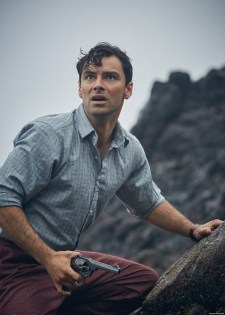 A production photo of Aidan Turner as Lombard, aimed with his trusty Webley.
