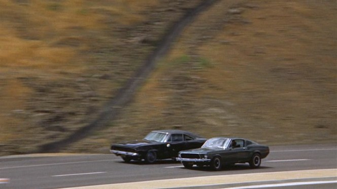 Two road beasts, one about to meet a fiery end.