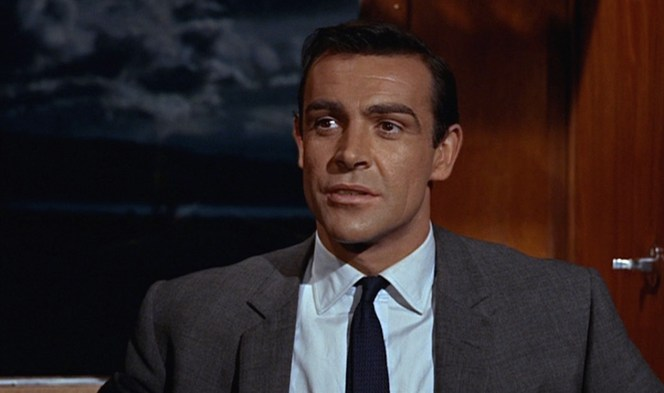 Bond tries that time-tested technique of bargaining for his life by insulting the man holding him at gunpoint. Ah,