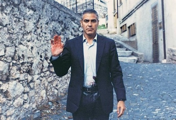 """A """"bloodied"""" George Clooney cheekily poses on location while filming The American."""