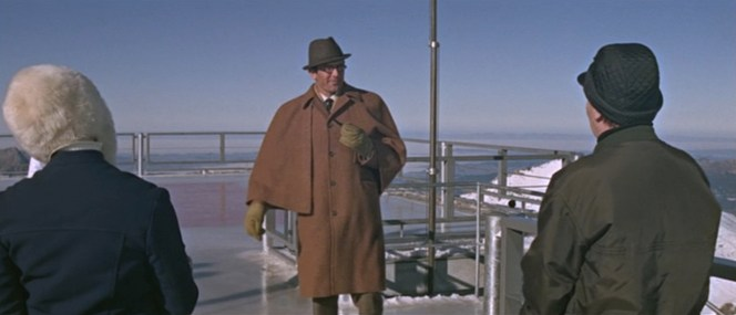 Bond re-dons his Ulster coat for a morning of curling activities with the girls of Piz Gloria.