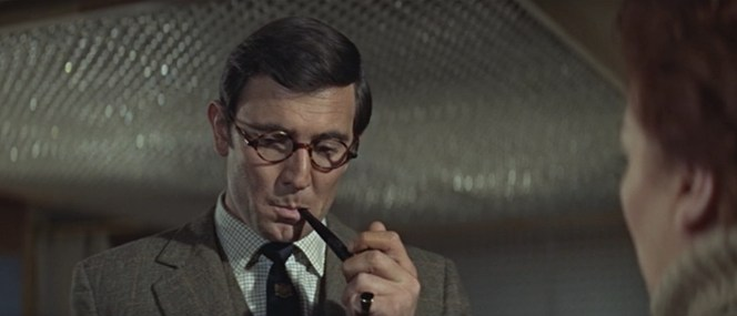 """Bond's """"props"""" are on display as he takes a puff from Sir Hilary's pipe."""