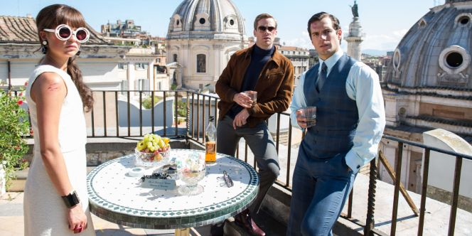 Alicia Vikander, Armie Hammer, and Henry Cavill. Hammer's brown suede jacket, turtleneck, and gray trousers have been covered in a previous post.