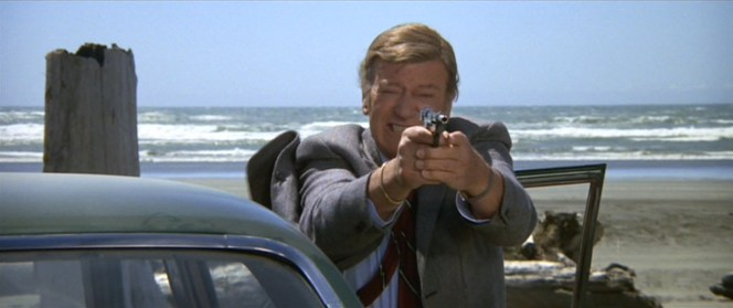 Only John Wayne could make a Browning Hi-Power look so small in someone's hands.
