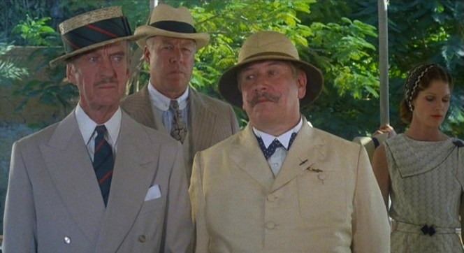 """Though Colonel Race, Andrew Pennington (George Kennedy), and Hercule Poirot (Peter Ustinov) are all adequately dressed for a sightseeing tour in late 1930s Egypt, only Colonel Race's ensemble - straw boater aside - is truly timeless. Also note Lois Chiles looking pensive over Peter Ustinov's left shoulder; the following year, she would star as """"Bond girl"""" Dr. Holly Goodhead in Moonraker."""