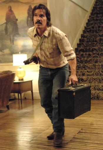 Llewelyn Moss tries to fight his way out of a scrape at the Eagle Pass Hotel.