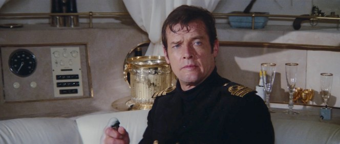 Roger Moore's two primary tools of seduction: a bottle of fine champagne and a strategically cocked eyebrow.