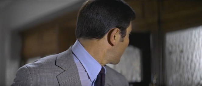 The life of a secret agent involves plenty of looking over your shoulder. In this case, it gives us a better view of Bond's distinctive glen check suiting.