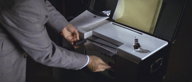 A safecracker and a copy machine? You've outdone yourself this time, Q.
