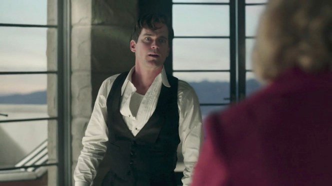 """Monroe's era-correct waistcoat gets some welcome exposure after rising from a nap in """"A Brady American Christmas"""" (episode 6)... while his white ribbed cotton sleeveless undershirt gets some indecorous exposure."""