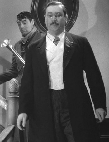 """John Alexander as """"Teddy Roosevelt"""" Brewster in Arsenic and Old Lace (1941). Peep Cary Grant over his shoulder as a manic Mortimer Brewster."""