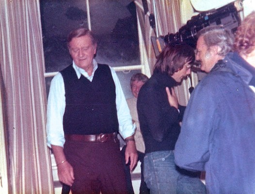 This behind-the-scenes shot of John Wayne on the Brannigan set shows his sweater vest tucked into his trousers.