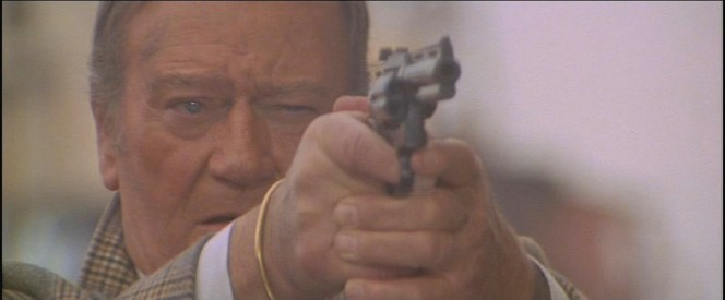 John Wayne with a six-shooter. You can take the Duke out of the wild west, but...