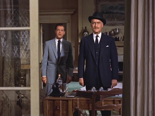 Margot's POV: an astonished Mark and rather self-satisfied Inspector Hubbard, both in navy ties, greet her upon her unexpected return home.