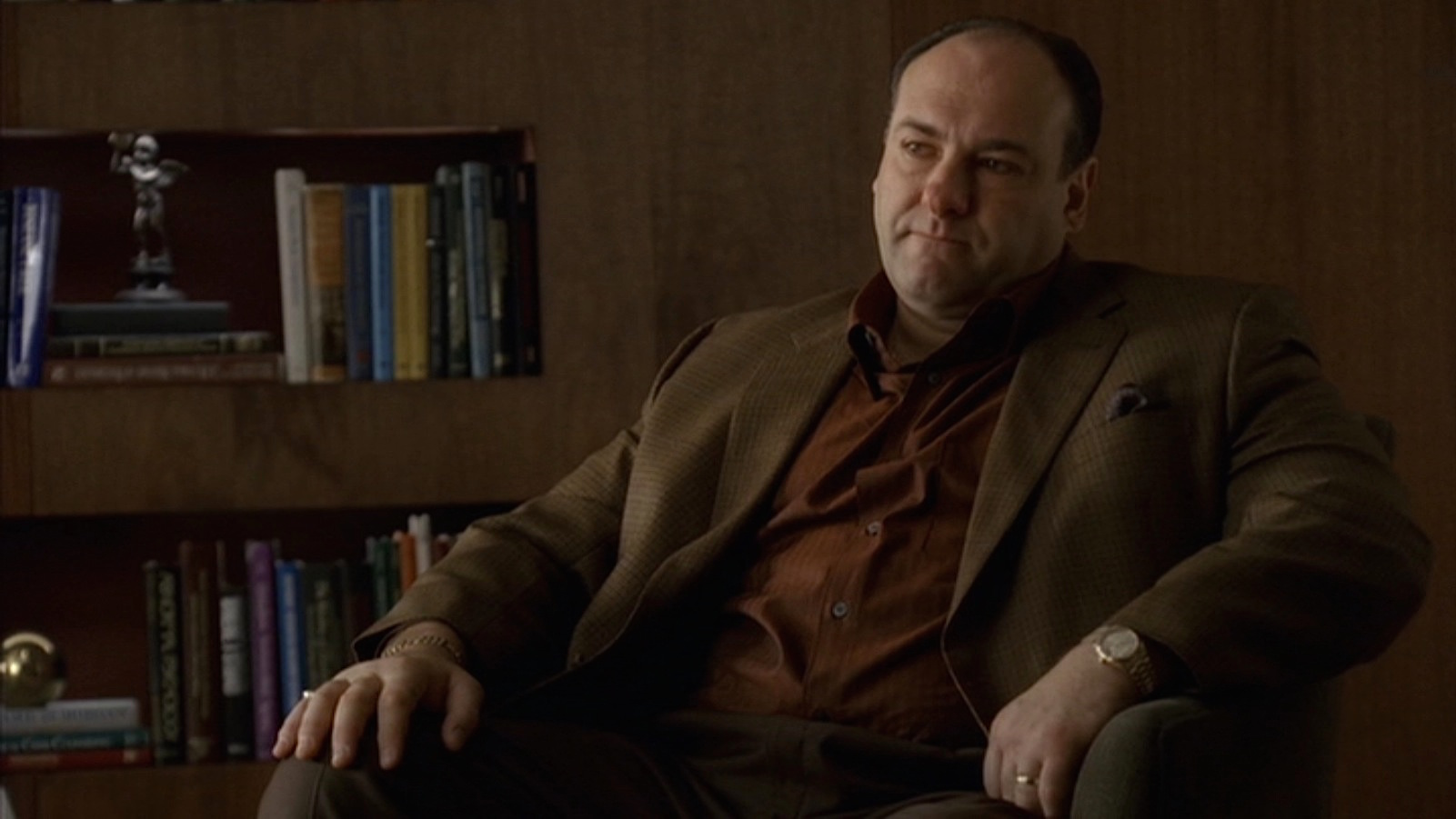 tony is sitting in dr. melfi's office.