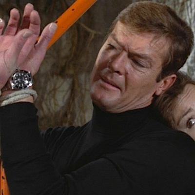 Roger Moore looks to his Rolex Submariner ref. 5513 to get James Bond out of a sticky situation in Live and Let Die.
