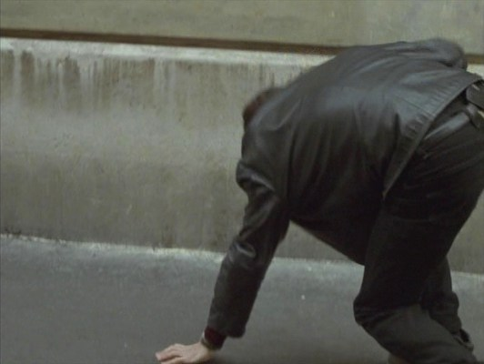 Sam takes a tumble in Paris after disarming Deirdre of her Jericho 941FB Compact pistol. Clipped to the back right of his belt (and thus concealing what may be a Levi's logo patch) is the holster for his own SIG-Sauer P228.
