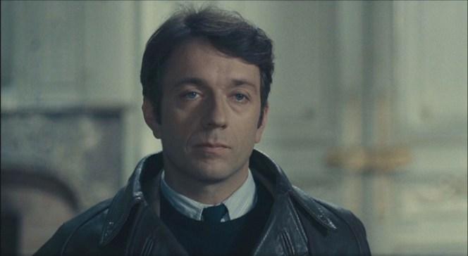 Jardie glares at his interrogators.