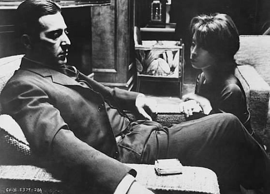 Promotional photo of Al Pacino and Talia Shire as Michael and Connie Corleone, respectively. Note Michael's deck of unfiltered Camels on the right arm of his chair.