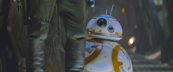 BB-8 lurks behind Han on the Millennium Falcon.
