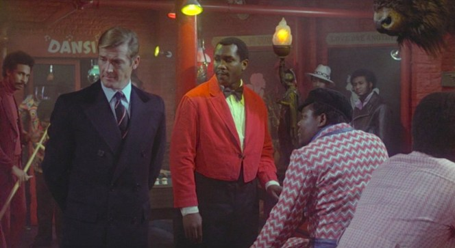 Given the choice, would you rather wear Bond's navy Chesterfield or the zig-zag jacket of the gentleman seated at the bar?