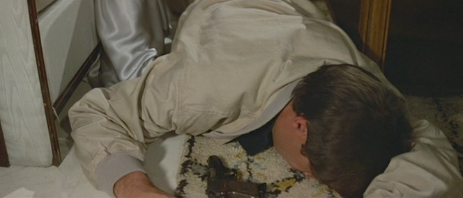 Bond drops his PPK in front of him after succumbing to the drugged martini.