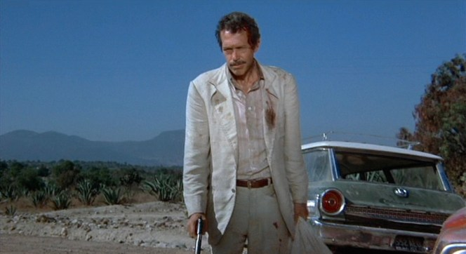 1911 pistol in one hand, Alfredo Garcia's head in the other, all that awaits Bennie now is payment for a job well done.