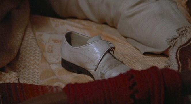 Bennie's left loafer joins him in bed with Elita.