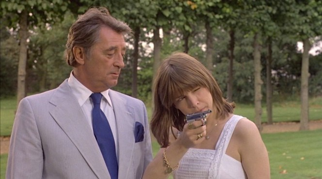 Marlowe is only slightly amused as Camilla Sternwood takes aim with her stainless Beretta .22.