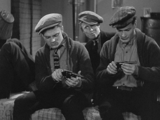 Tom and Matt examine their new revolvers. While movies of this era were not typically focused on firearm accuracy, the Colt Police Positive was indeed being produced by 1915 and thus their appearance in this scene is appropriate.