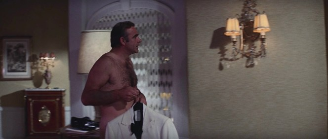 The condemned man prepares for his hearty breakfast. Note the low briefs, colored to match Sean Connery's skin tone.