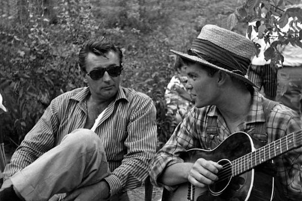 "Robert Mitchum on set with Randy Sparks, who sang the film's Mitchum-penned theme song, ""The Ballad of Thunder Road"", for the opening credits."