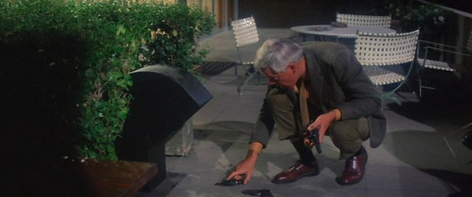 His own Smith & Wesson Model 29 in hand, Walker tosses away the gats he grabbed from Mal's bodyguards.