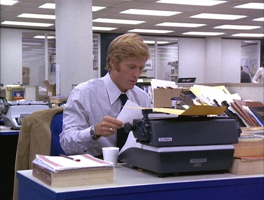 Woodward works on a story on his Olympia typewriter.