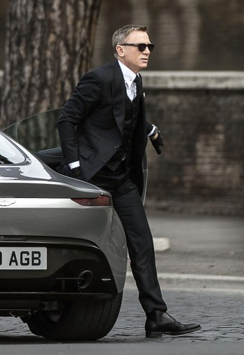 Daniel Craig as James Bond, exiting an Aston Martin DB10 prototype in Spectre (2015)