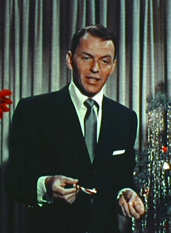 "Frank Sinatra trims the tree during the opening of ""Happy Holidays with Bing & Frank,"" the 1957 Christmas special episode of The Frank Sinatra Show."