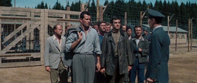 Hendley greets Group Captain Ramsey upon his return to camp with the few surviving escapees.