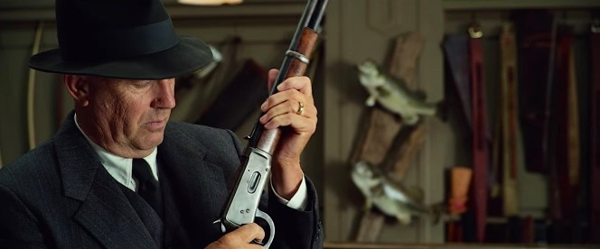 Amidst the automatic and semi-automatic rifles arming him for his journey, Hamer finds comfort in the mechanical reliability of a classic Winchester rifle.