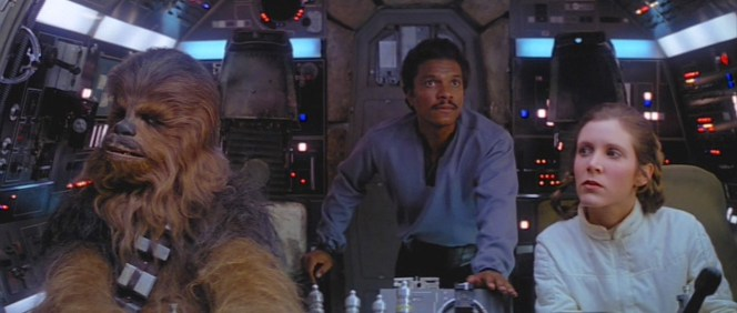 The abandonment of this grandiose garment strips Lando down to just his shirt, pants, belt, and boots, more resembling his new confederates in the Rebel Alliance.
