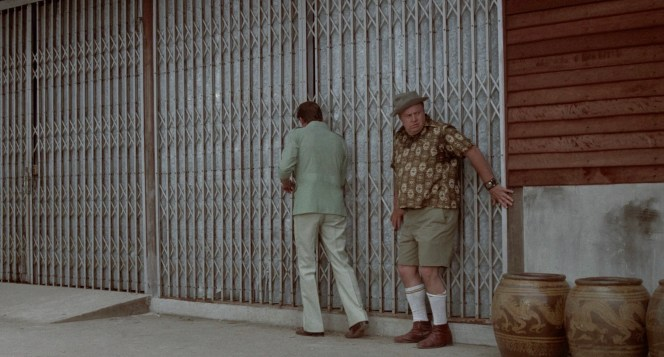 Roger Moore and Clifton James in The Man with the Golden Gun (1974)