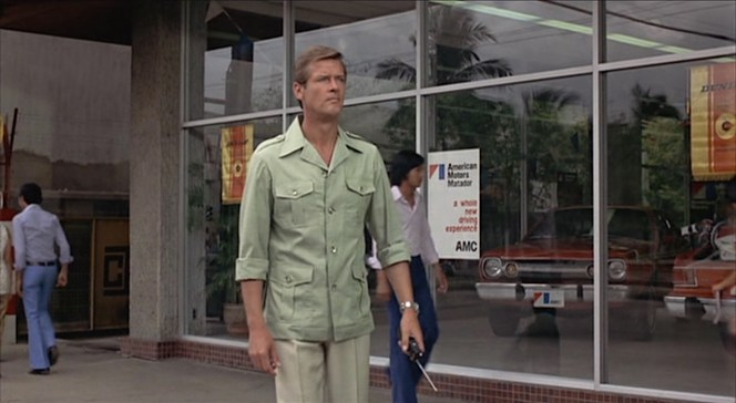 Even in an urban setting like Bangkok, Bond's safari shirt-jacket provides comfort in the warm climate and is appropriately dressed up for the city with his linen trousers and leather loafers.