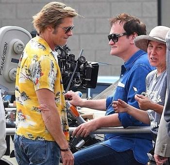 Brad Pitt confers with Quentin Tarantino on set.