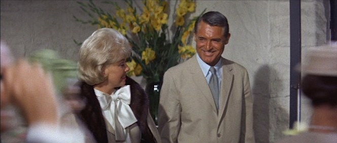 Cathy and Philip share a smile as they walk through their hotel lobby.