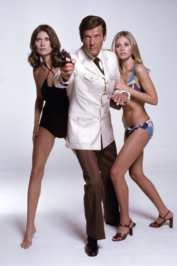 Roger Moore, flanked by co-stars Maud Adams and Britt Ekland, in his second film as James Bond, The Man with the Golden Gun (1974)