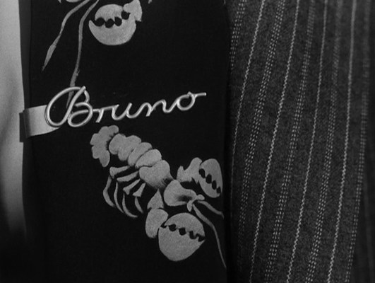 """""""Well, I suppose you think it's corny, but my mother gave it to me, so I have to wear it to please her,"""" Bruno overshares, establishing his twist on the classic Oedipal complex within seconds of making Guy's acquaintance."""