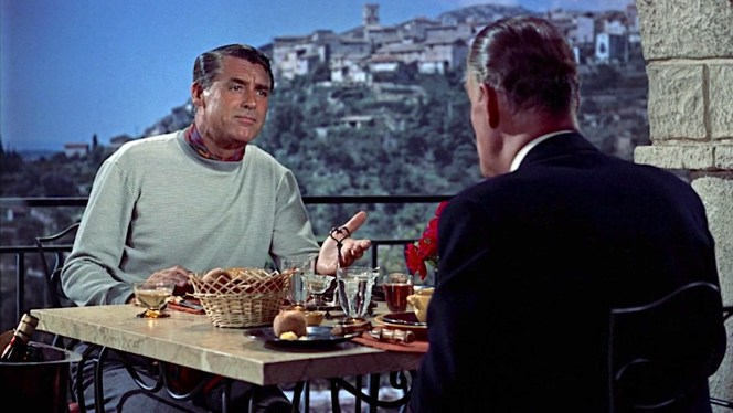 """Robie explains to Hughson that he honed his agility as """"a member of an American trapeze act in the circus that traveled in Europe,"""" mirroring Cary Grant's own experience performing acrobatics and comic sketches at the National Vaudeville Artists Club when he was in his early 20s."""