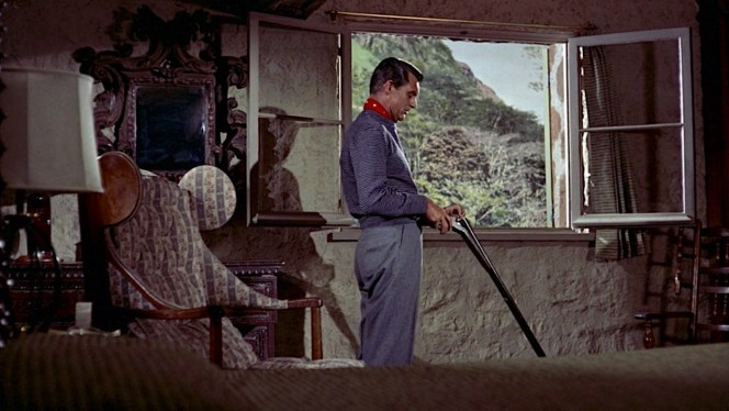 If this was anyone other than the charming Cary Grant loading a shotgun, we may wonder if he was planning on using it against the police.