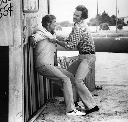Production photo of Burt Reynolds kicking ass and taking names in Gator.
