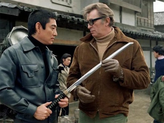 Ken Takakura and Robert Mitchum on the set of The Yakuza. Mitchum's sunglasses are likely the actor's own as they don't appear on screen.