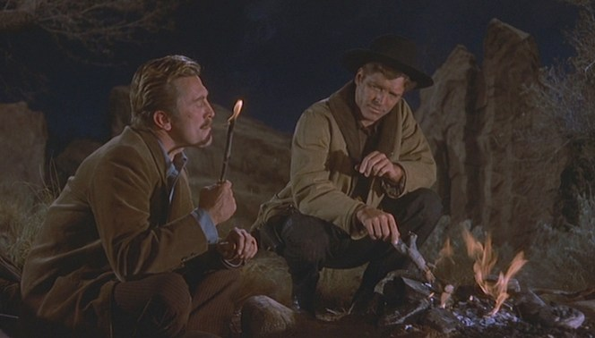 Smoking may be bad for your health, but the tubercular Doc Holliday knows his end is near anyway so he opts for one of the coolest on-screen depictions of lighting up, using the flaming end of a stick from his campfire to ignite one of his hand-rolled cigarettes.